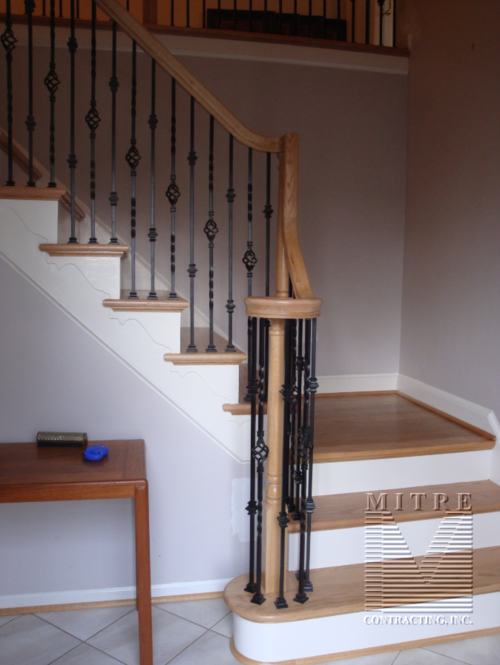 New Bullnose starting step with volute and wrought iron balusters