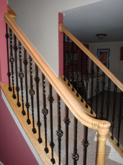 "Oak Rails with ""S"" fitting and wrought iron balusters"