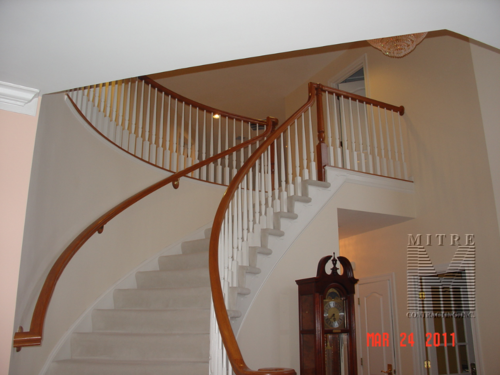 Carpeted curved stairway before installation of oak treads and risers