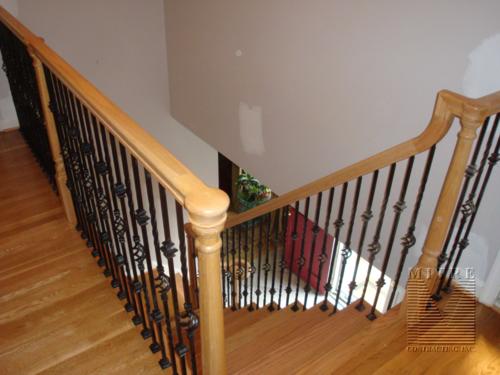 Balcony railing looking down into foyer