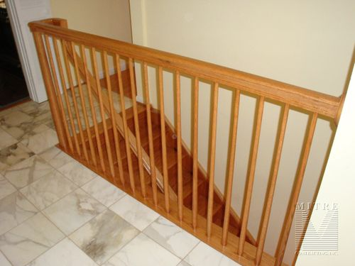 Custom newels, over the post railings, oak stairway railings