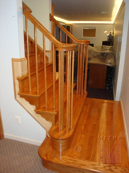 New open oak treads with brackets, custom newel posts, oak balusters, full volutes