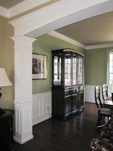 Dining Room with custom millwork archway, chair rail and panel moulding shadowboxes
