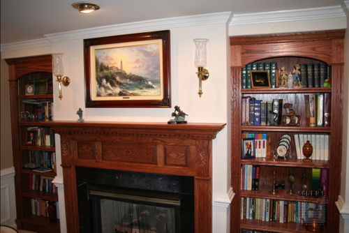 Oak mantle with oak bookcases at fireplace