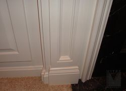 Detail of the base of the pilaster showing the recessed panel and plinth