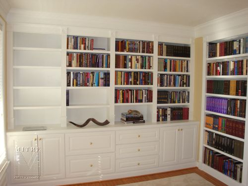 Built-In Cabinetry with filing drawers, fluted pilaster stiles, raised panel doors