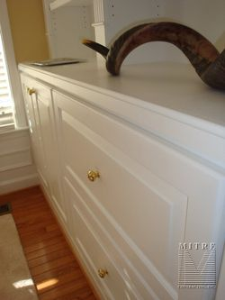 """Built-In Cabinetry- Close up of the """"ogee"""" counter top edge profile, and the solid maple raised panel doors and drawer fronts"""