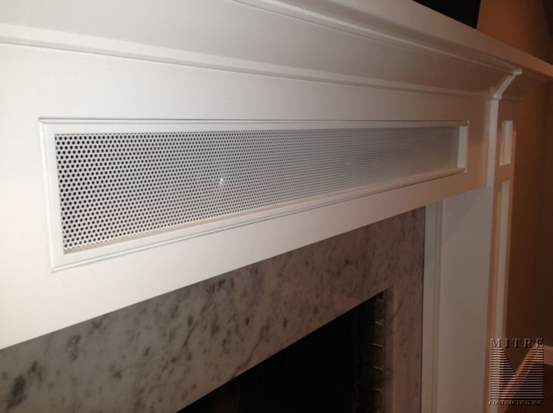 Craftsman Style Mantel with storage - close up of removeable speaker panel