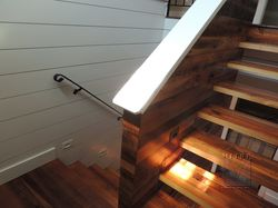 Stairway reclaimed barnwood stair treads & wall treatment