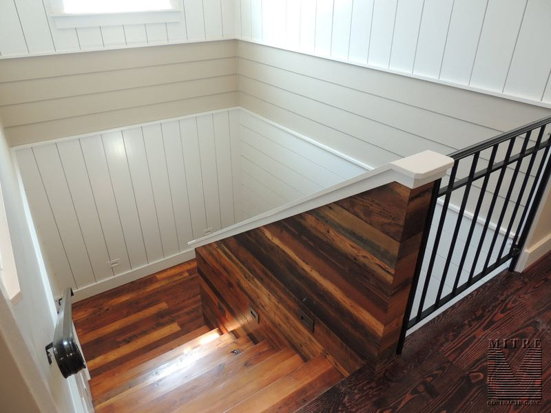 Stairway of reclaimed barn wood and custom wall and ceiling treatments