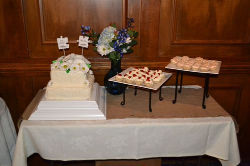 Cake table with wedding cake and miniature pies