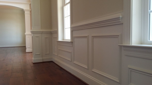 Wainscot shadowboxes under chair rail