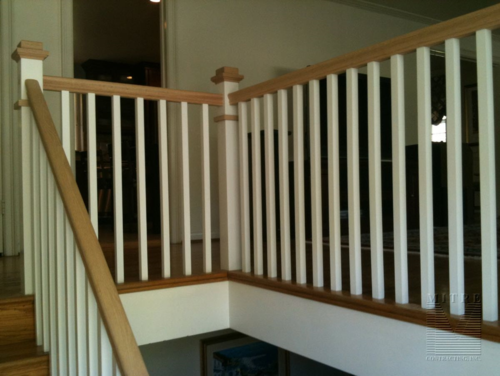 Boxed newel post, oak railings, square balusters