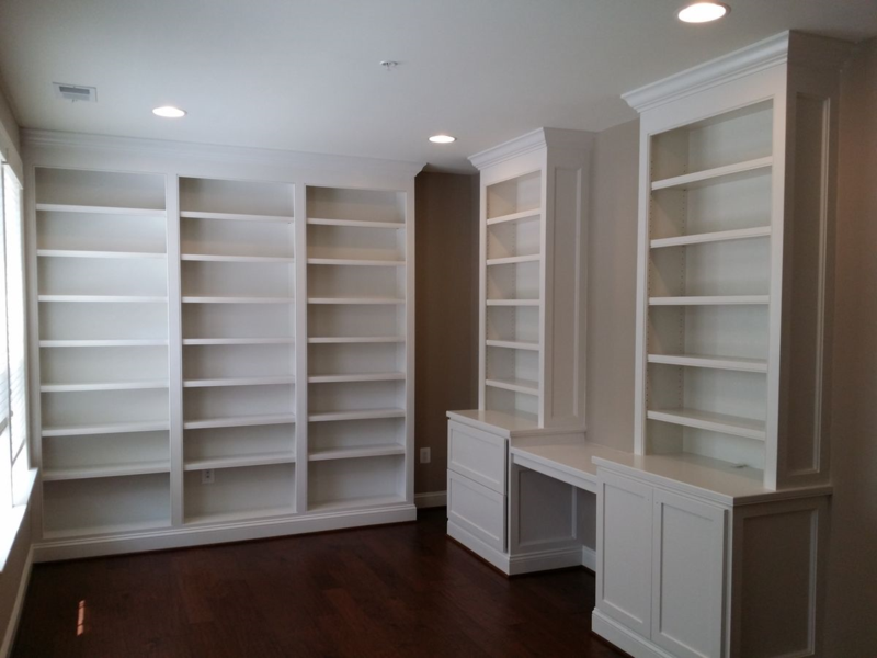 Painted built-in cabinets and bookcases with filing drawers