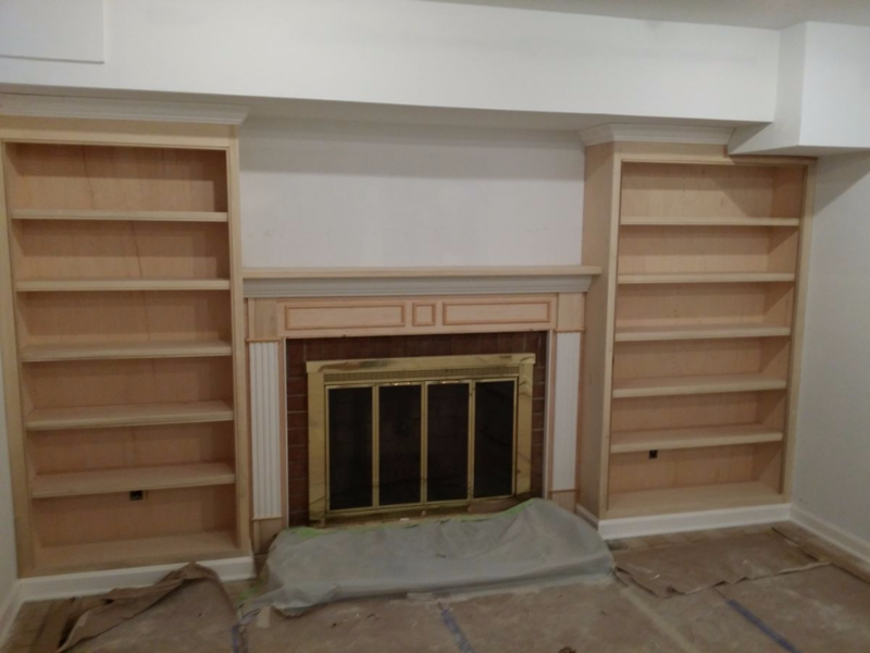 Fireplace mantel or mantle between bookcases