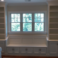A window seat built-in with bookcases