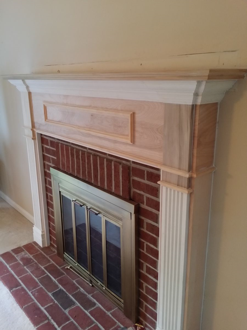 Unpainted fireplace mantel