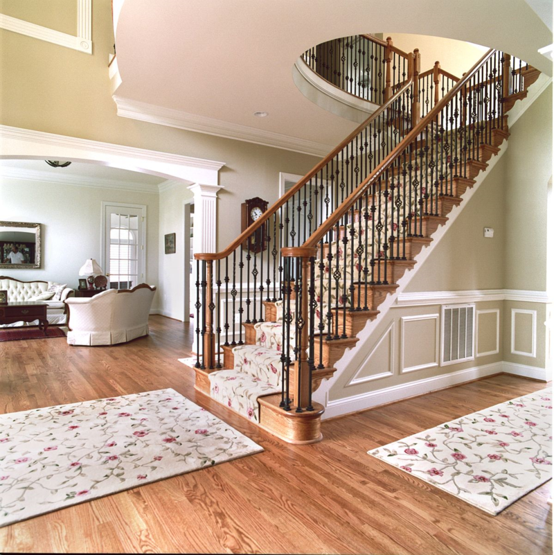 Oak Stair railings with wrought iron balusters