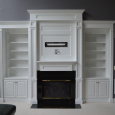 Built-in cabinetry with mantel surround feature