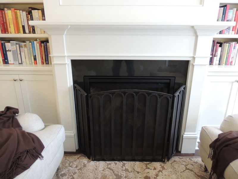 Craftsman style mantel with upper recessed wood panel for the flat screen TV