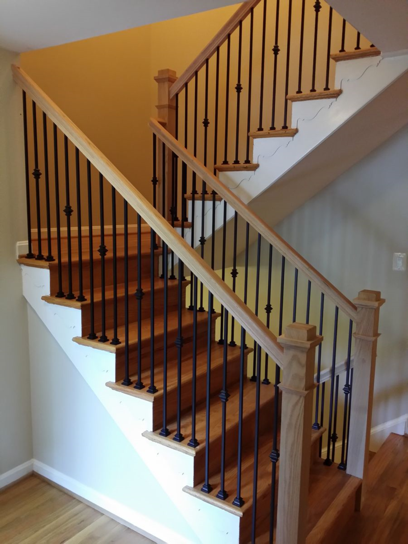 Stair Railings With Black Wrought Iron Baers And Oak Boxed Type Newel Posts