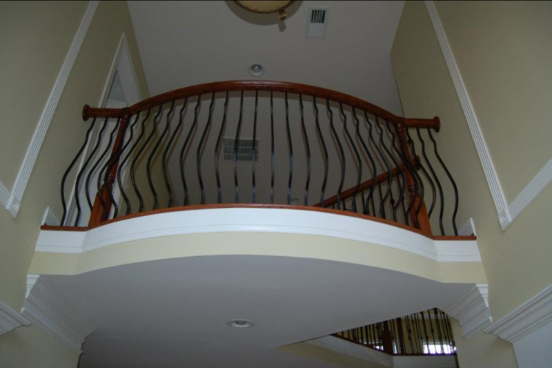 "Overlook Railing with ""belly"" type wrought iron balusters"