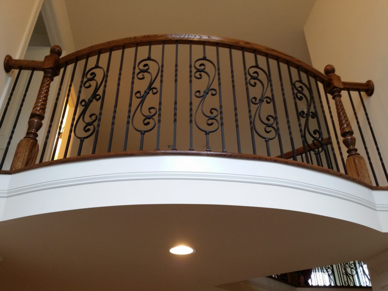 Overlook stair railing with wrought iron balusters