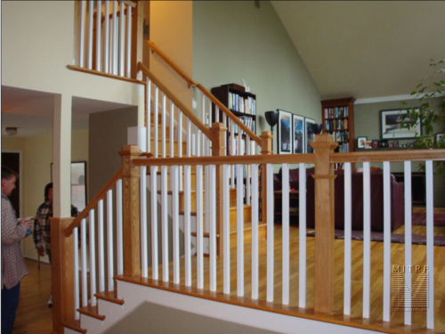 Railing with boxed newels, square balusters and 6010 handrail