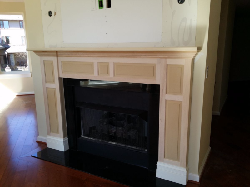 Fireplace mantle with raised panels