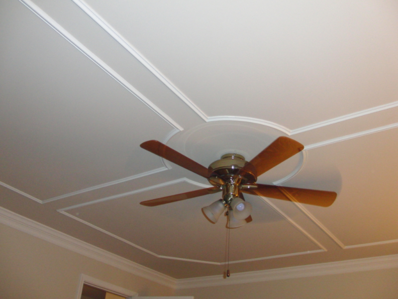 Ceiling with 4 panel moulding panels with circular center