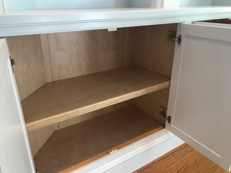 Interior base cabinetry with clear coat polyurethane finish