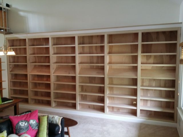 Wall Of Bookcases With Angled Display Shelves