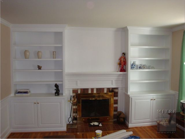 built ins built in cabinetry surrounding fireplace