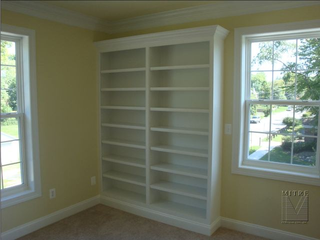 Bookcases in a bedroom area