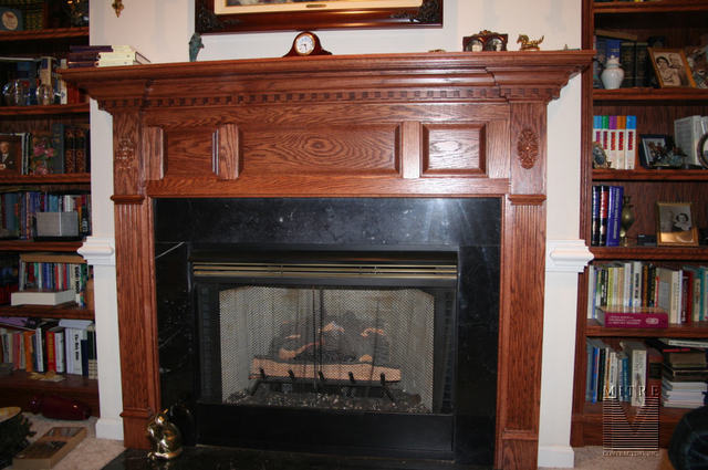 Mantel with raised panels