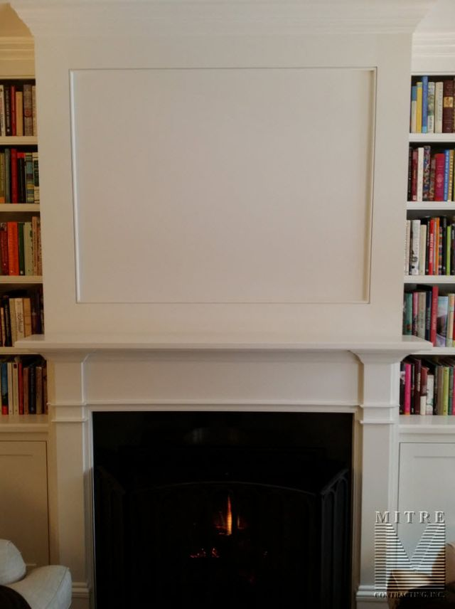 Fireplace mantel with built-in cabinetry