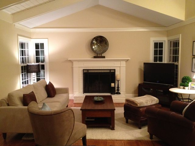 Mantel for a raised hearth fireplace
