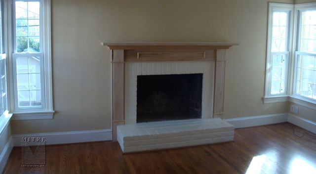 Mantel on a raised hearth fireplace