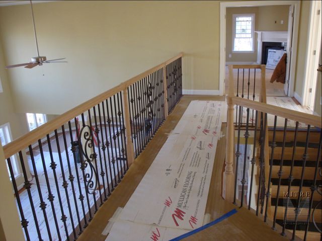 Wrought Iron Balusters with oak